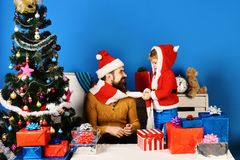 Family holidays concept. Christmas family opens presents stock photos