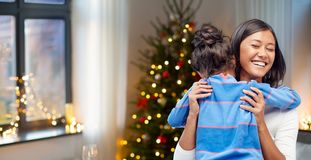 Happy mother hugging her daughter on christmas royalty free stock image