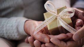 Senior couple hands holding gift box stock video