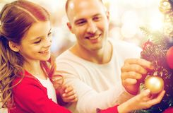 Father and daughter decorating christmas tree Royalty Free Stock Images