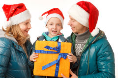 Family Holliday. Happy Father,Mother and Son on the White Background,Dressed in Santa Hats ,with Present Box,Close-up Royalty Free Stock Photos