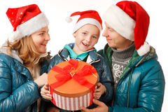 Family Holliday. Happy Father,Mother and Son on the White Background,Dressed in Santa Hats ,with Present Box,Close-up Stock Photo