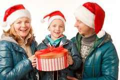 Family Holliday. Happy Father,Mother and Son on the White Background,Dressed in Santa Hats ,with Present Box,Close-up Stock Photography