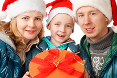 Family Holliday. Father,Mother and Son on the White Background,Dressed in Santa Hats ,with Present Box,Close-up Stock Photos