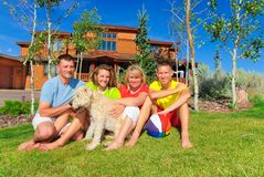Family by home. Complete family with dog by their home Stock Images