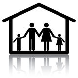 Family Home. Family holding hands inside a home. Conceptual image or icon for subjects related to family home, housing and real estate Royalty Free Stock Photo