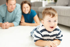 Family at home. Happy family lying on floor in living room. Selective focus on little boy Royalty Free Stock Photography