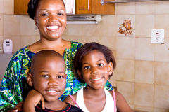 Family at home. Happy african family at home in the kitchen Royalty Free Stock Images