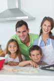 Family home baking together in the kitchen Stock Photography