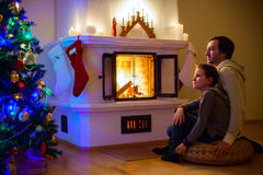 Family at home on Christmas eve Stock Photos