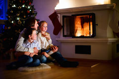 Family at home on Christmas eve Stock Image