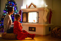 Family at home on Christmas eve Royalty Free Stock Photos