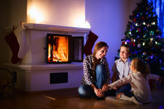 Family at home on Christmas eve Royalty Free Stock Photography