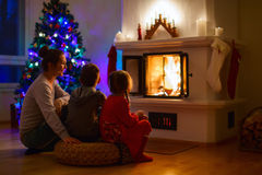 Family at home on Christmas eve Stock Images