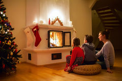 Family at home on Christmas eve Royalty Free Stock Image