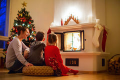 Family at home on Christmas eve Stock Photo