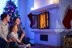 Family at home on Christmas eve Stock Photography