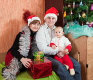 Family at  home with  Christmas tree Royalty Free Stock Photo