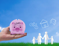 Family Home Concept. Family home, life and dream concept, paper cut people icon and hand holding piggy bank loan debt royalty free stock photo