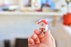 Family home concept. Miniature house in female hands. Buying your own home concept. Family home concept. Miniature house in female hands stock image