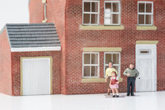 Family home concept with model house and people on white backgro Stock Images