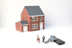 Family home concept with model house and people. On white background royalty free stock image