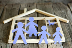 Family and home concept, paper silhouettes. On wooden boards royalty free stock photography