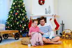 Family at home decorated for Christmas Stock Photography