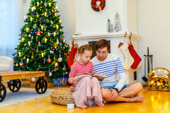 Family at home decorated for Christmas Stock Images