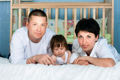 Family home - father, mother and little daughter Stock Photography