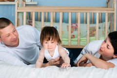 Family home - father, mother and little daughter Royalty Free Stock Photography