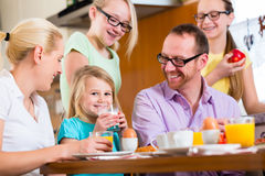 Family at home having breakfast in kitchen Stock Images