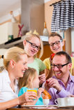 Family at home having breakfast in kitchen Royalty Free Stock Photo