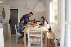 Family At Home In Kitchen Making Pizzas Together Stock Images