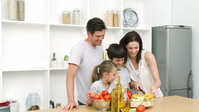 Family at home in Kitchen Preparing Lunch Royalty Free Stock Photography