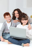 Family at home with laptop computer Royalty Free Stock Image