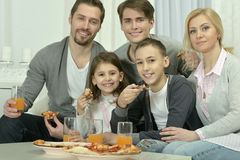 Family at home with pizza Royalty Free Stock Photo