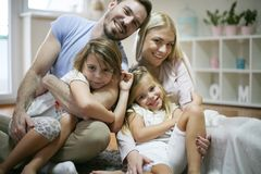 Smiling family. Portrait of young family. royalty free stock image