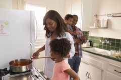 Family At Home Preparing Meal In Kitchen Together royalty free stock images