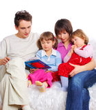 Family at home reading book. Happy Family at home reading book stock photo