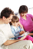 Family at home reading book Royalty Free Stock Images
