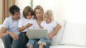 Family at home shopping online stock footage