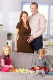 Family at home smiling Stock Image