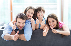 Family at home with thumbs up Royalty Free Stock Photography