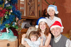 Family at home together during Christmas Stock Photos