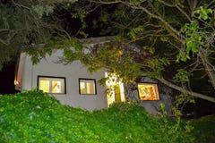 Family home under a dark sky Stock Image
