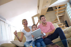 Family at home using tablet computer Royalty Free Stock Image