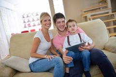 Family at home using tablet computer Stock Photo