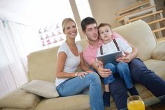 Family at home using tablet computer Stock Images