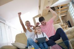 Family at home using tablet computer Stock Photography